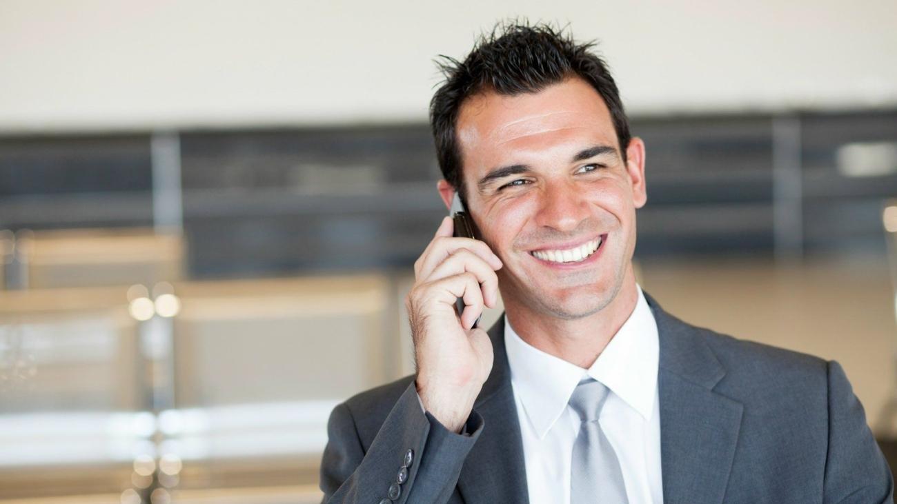 businessman-phone-laughing-business-man