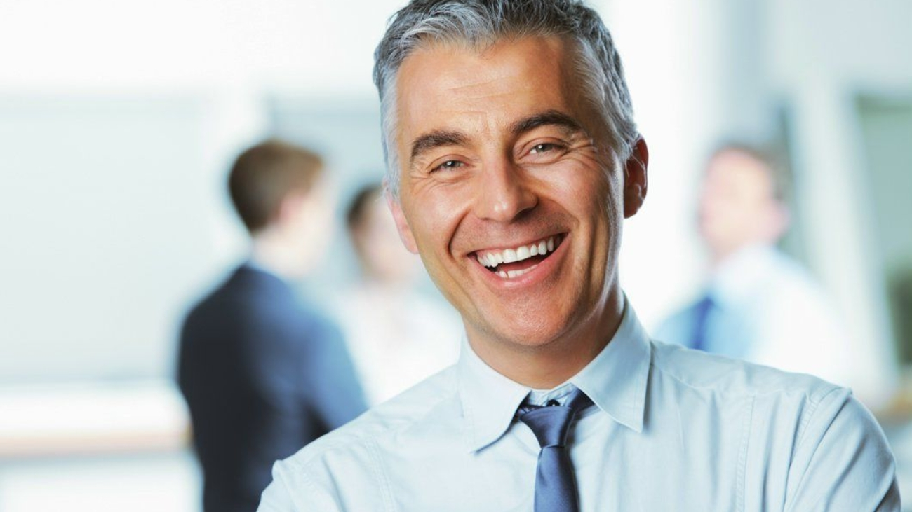 mature-businessman-smiling-46194205-business-man