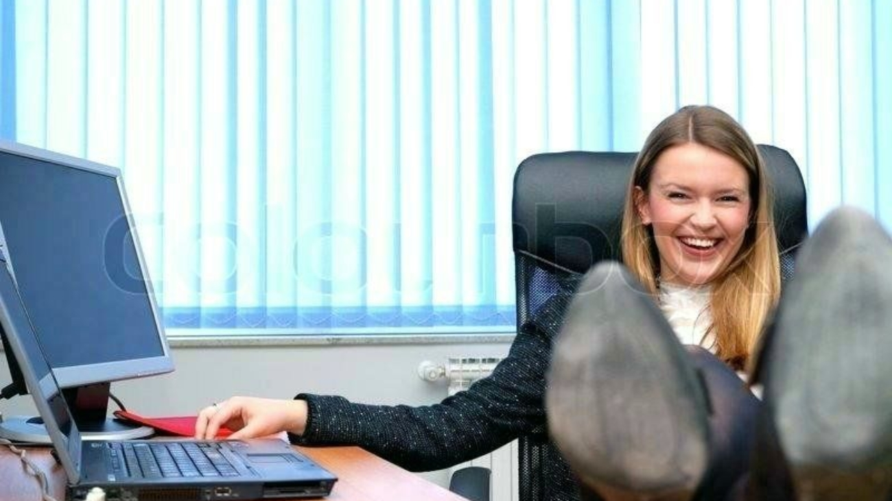 woman-at-desk-business-woman-relaxing-with-her-feet-on-the-desk-stock-photo-woman-pushing-desk-away-gif-business-woman